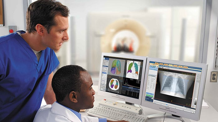 Clinicians analyzing high resolution radiology scan images